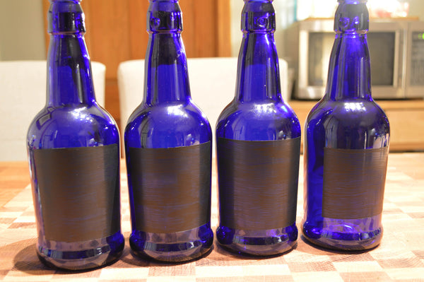 Once your bottles have cooled, remove them from the oven ...