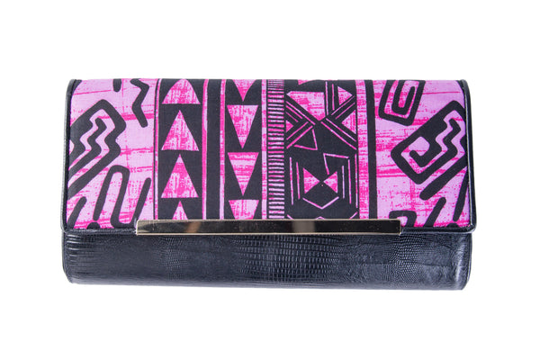 Pink twirls embossed lizard clutch