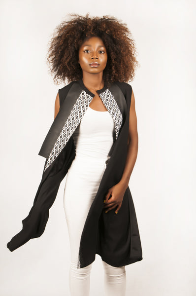 Tunic with black and white geometric print and black leather