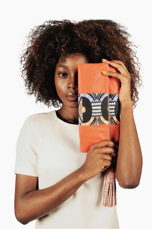 Fold over leather clutch/ pouch with African print detail - Orange