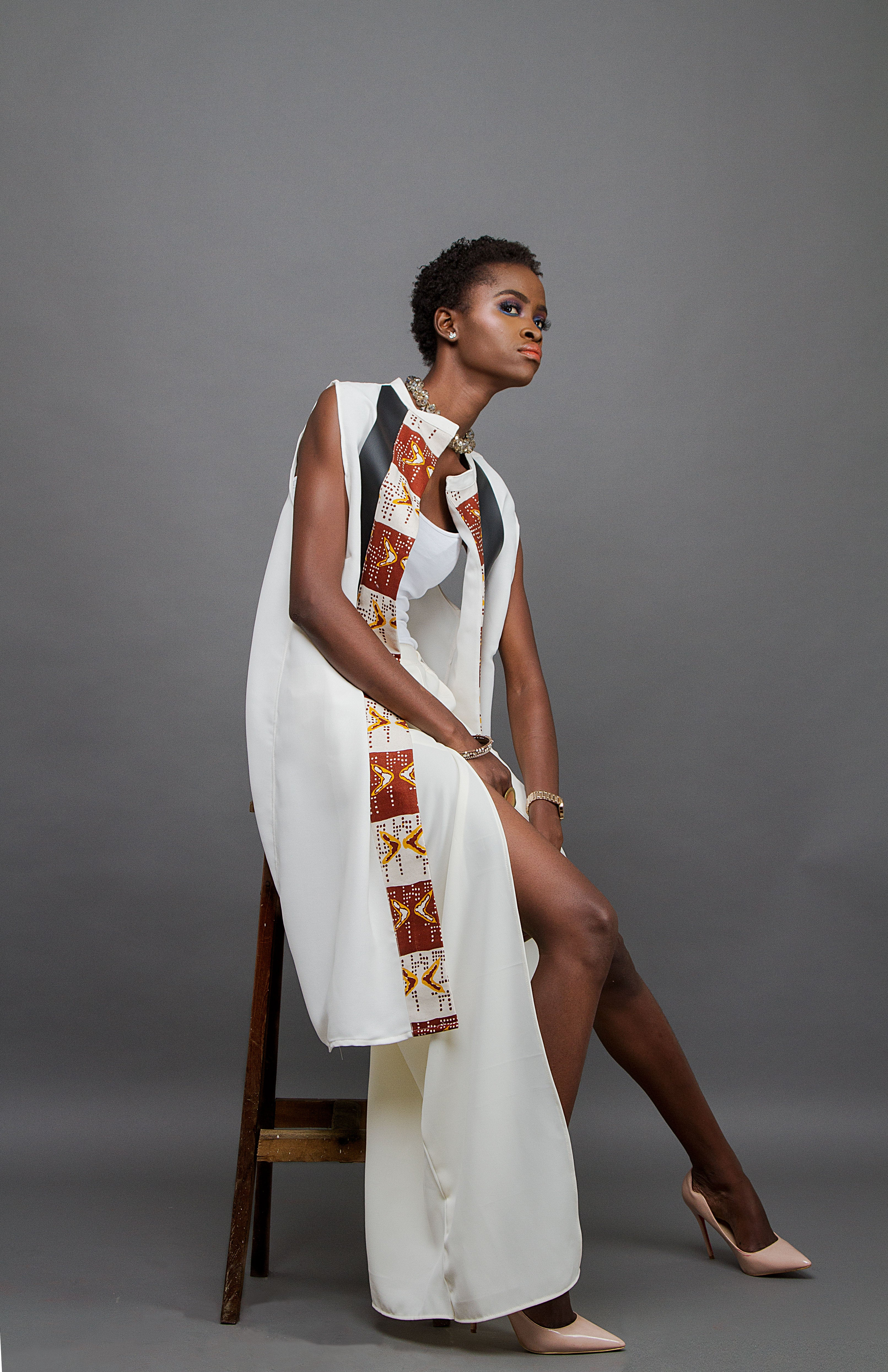 White tunic with black leather and Bogolan print panel