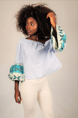white off shoulder top with blue bogolan