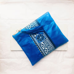 Blue leather and print clutch