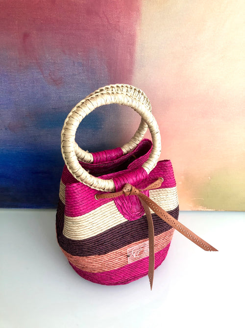 Multicoloured woven bag - fuchsia