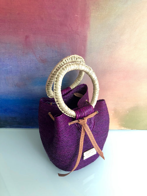 Purple woven bucket bag