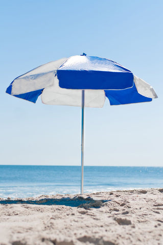 Blue and White Vinyl umbrella on beach