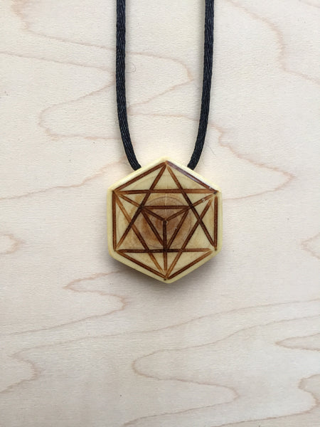 Handmade upcycled Christmas tree sacred geometry jewelry merkabah necklace front view