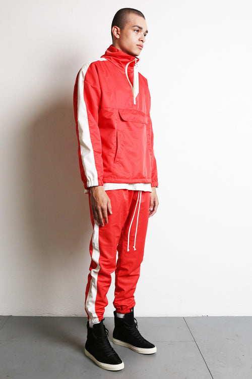 parachute track pant in red/ivory by daniel patrick