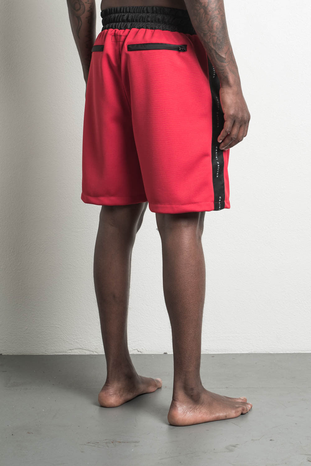 roaming gym short in red/black by daniel patrick