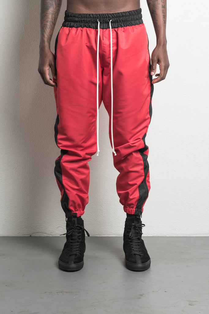 parachute track pant in red/black by daniel patrick