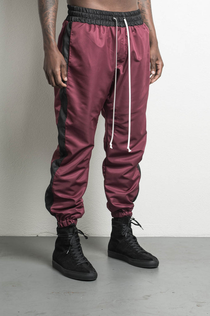 parachute track pant in maroon/black by daniel patrick