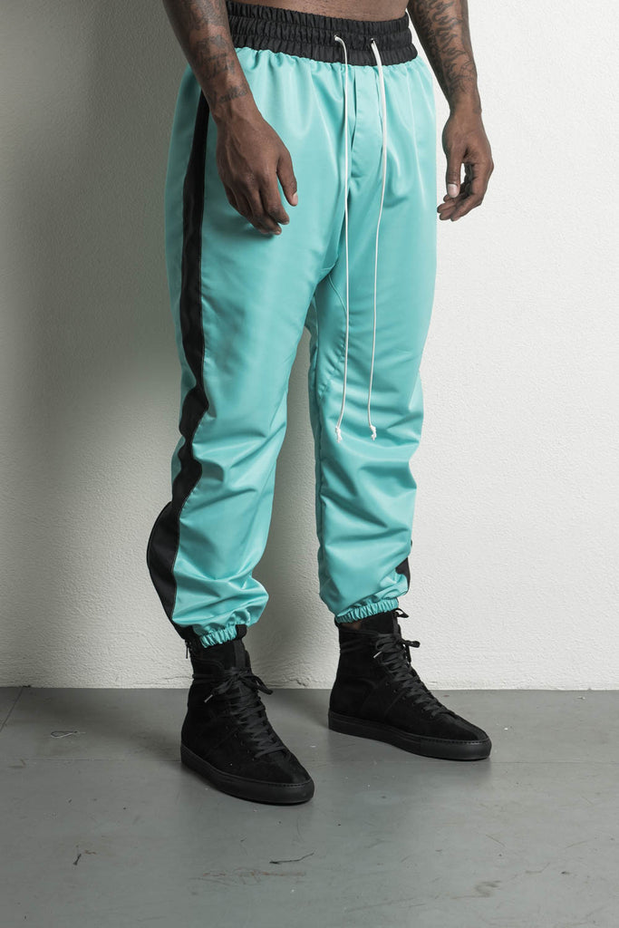 parachute track pant in turquoise/black by daniel patrick