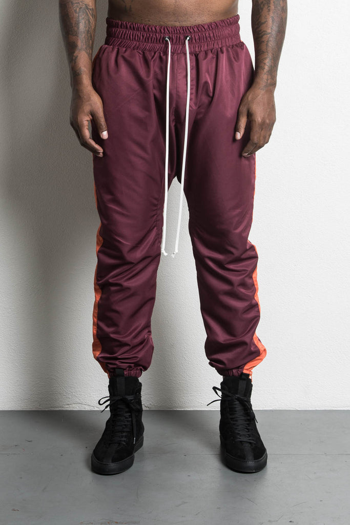 parachute track pant in maroon/orange by daniel patrick