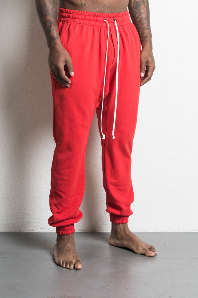 roaming track pant in red by daniel patrick