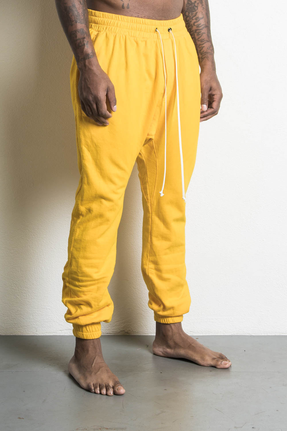 roaming track pants by daniel patrick in yellow