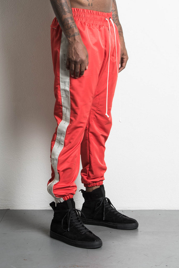 dp parachute track pant in red/natural by daniel patrick