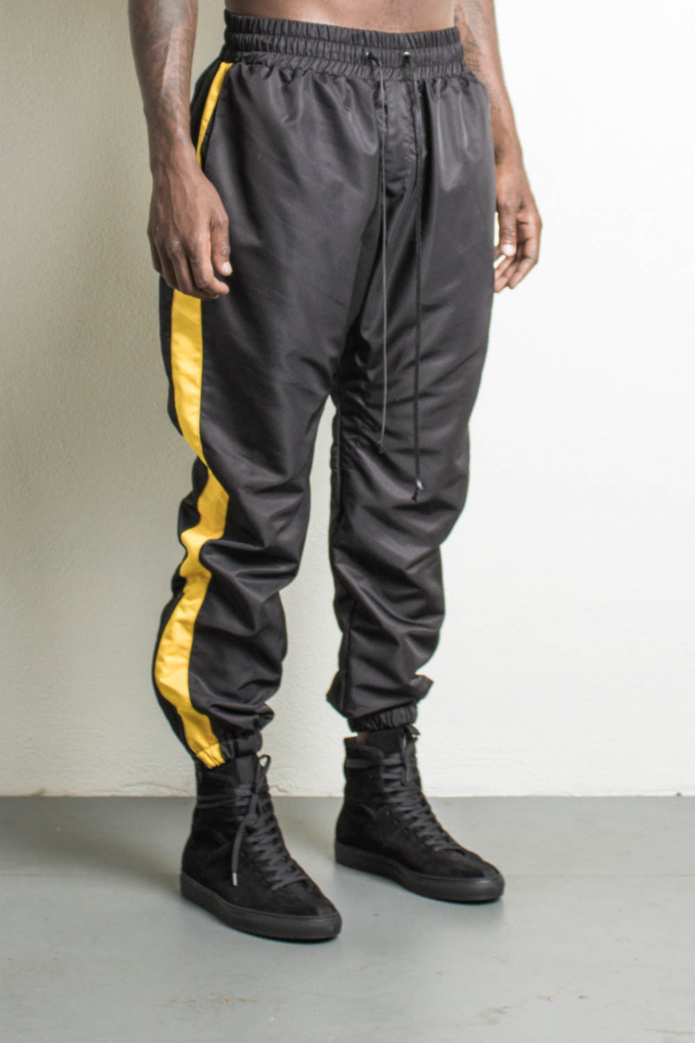 % polyester microfiber parachute track pants lining: nylon mesh dp tape detail rear pocket natural waxed drawcord 10