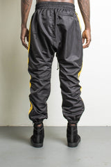 parachute pants in black/yellow by daniel patrick