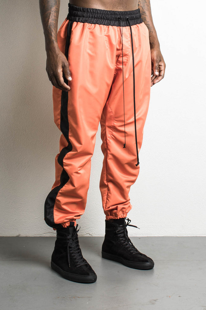 parachute pants in orange/black by daniel patrick