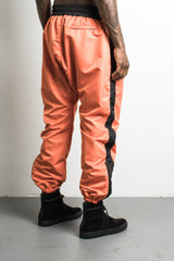 parachute track pants in orange/black by daniel patrick