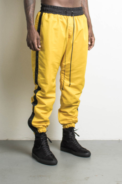 parachute track pants in yellow/black by daniel patrick