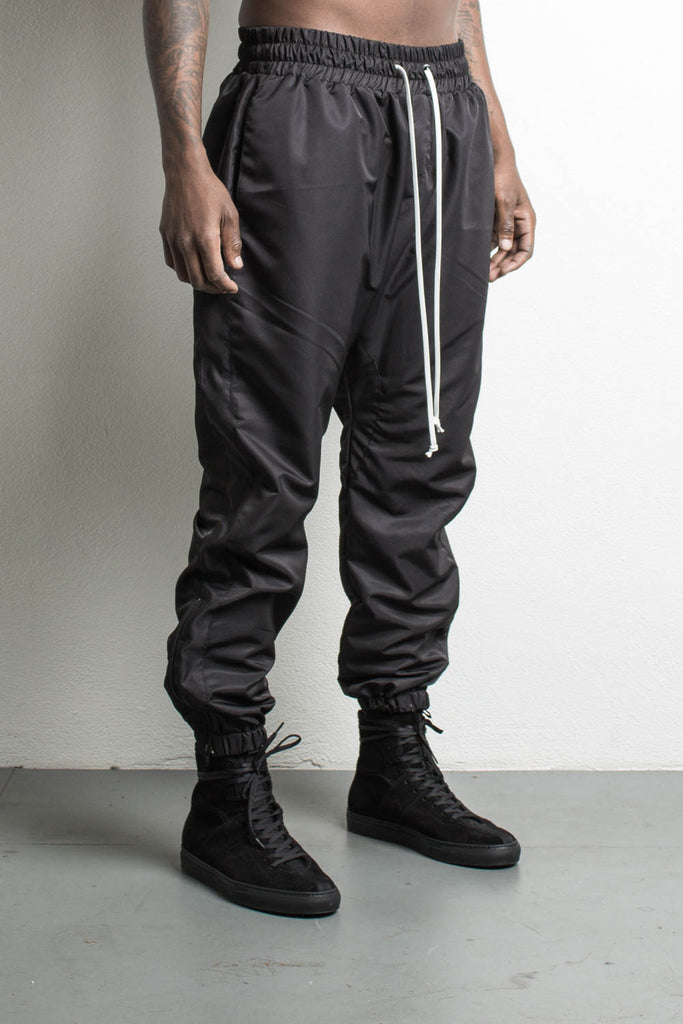 parachute track pant in black by daniel patrick