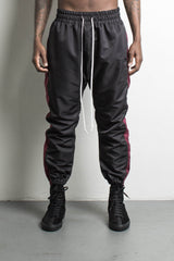 parachute track pant in black/maroon by daniel patrick