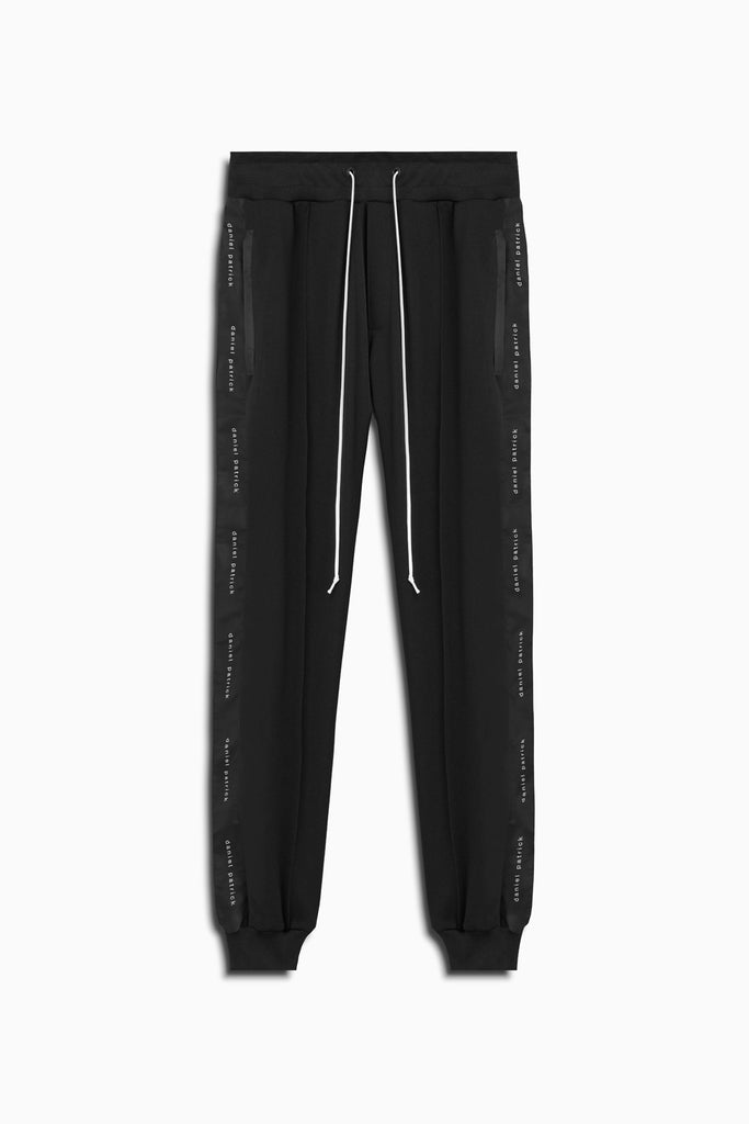 slim track pant in black by daniel patrick