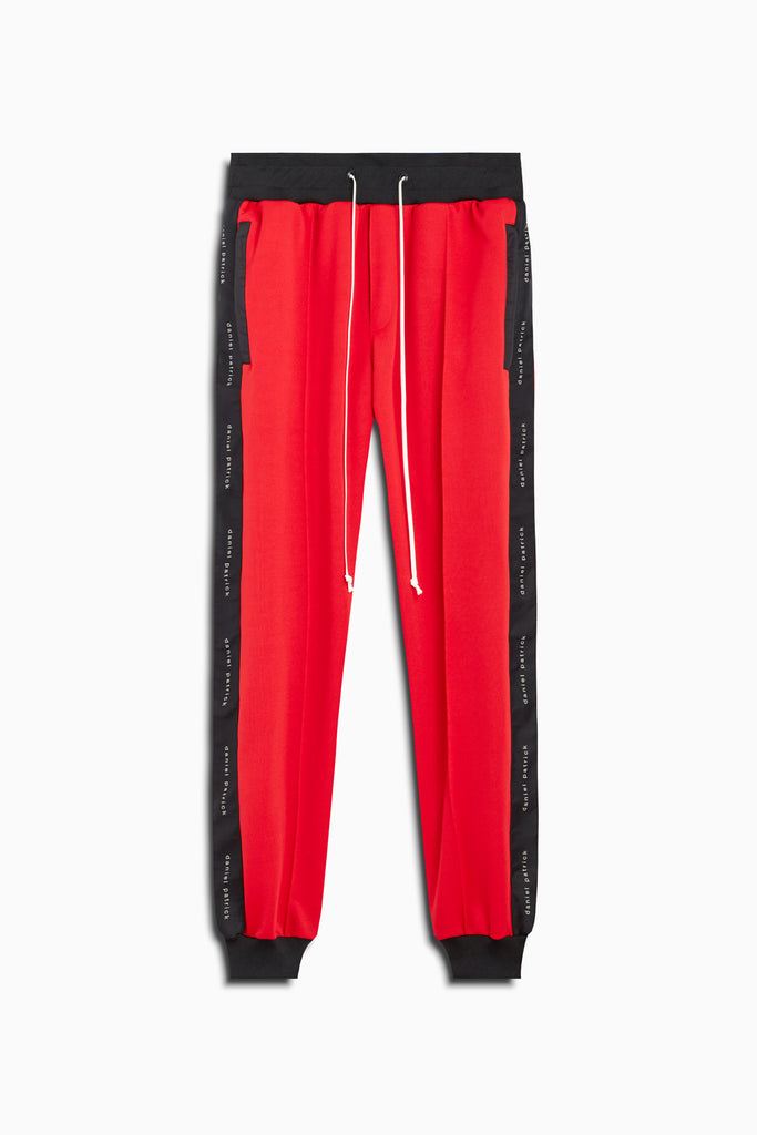 slim track pant in red/black by daniel patrick