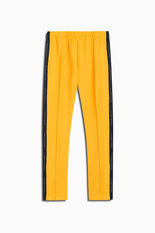 womens heroine track pant in yellow/black by daniel patrick
