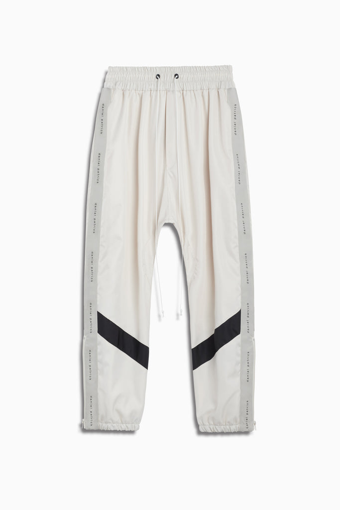 dp parachute track pant ii in ivory/black by daniel patrick