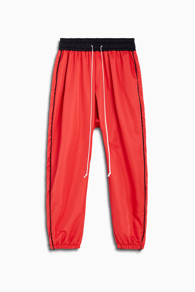 parachute track pant piping in red/black/black by daniel patrick