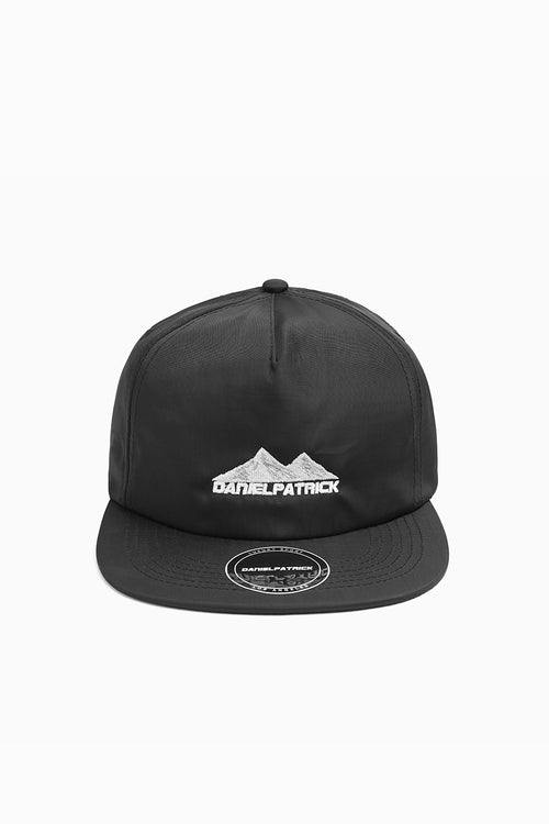 Black nylon moving mountains cap by daniel patrick