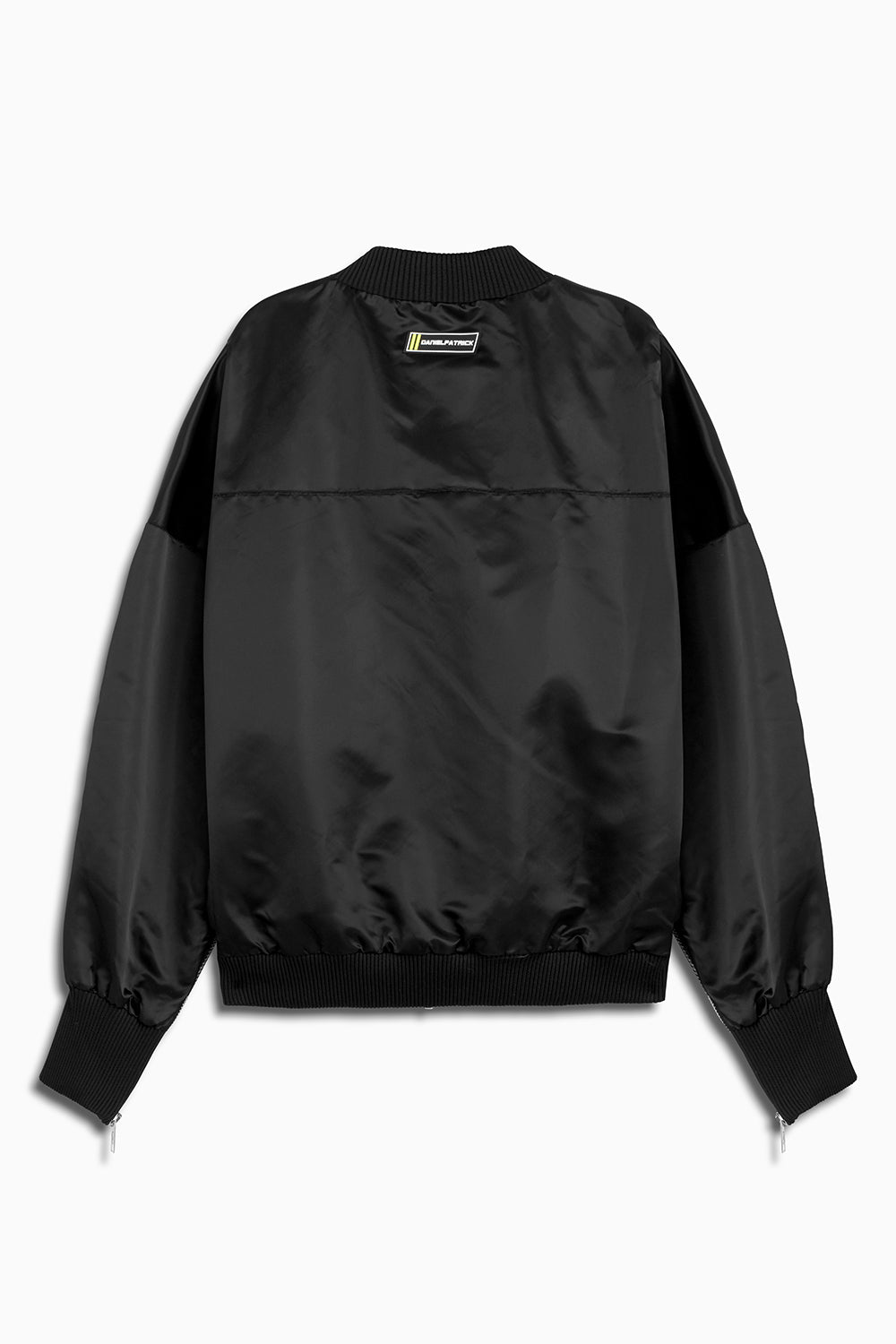 DP embroidered sleeve bomber in black/cobalt by daniel patrick