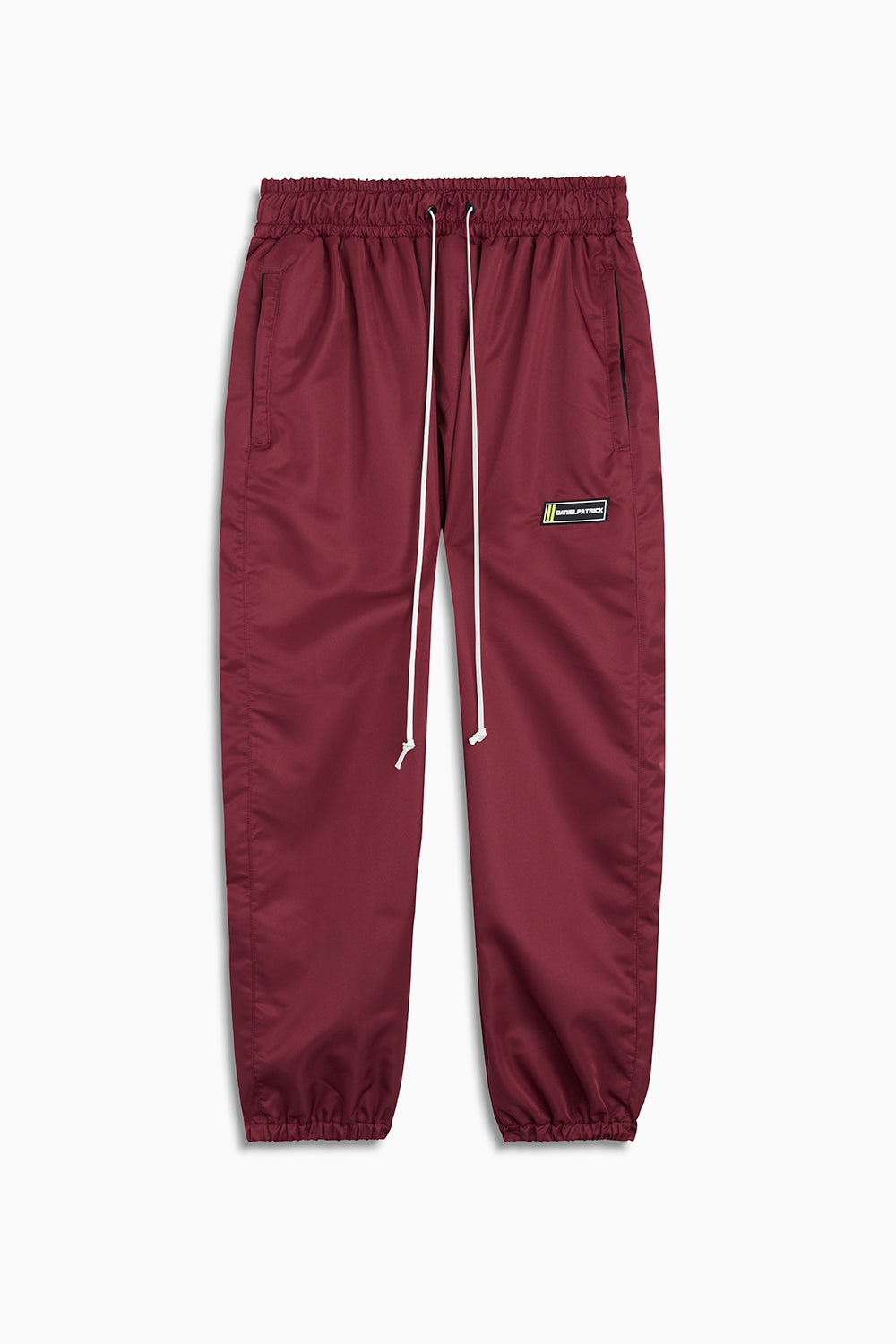 parachute track pant iv in maroon by daniel patrick