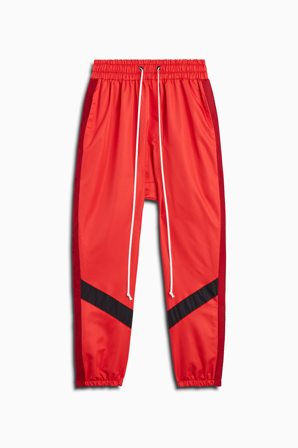 dp parachute track pant ii in red/black by daniel patrick