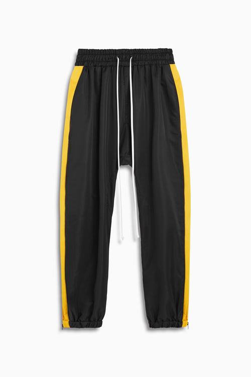 parachute track pant in black/yellow by daniel patrick
