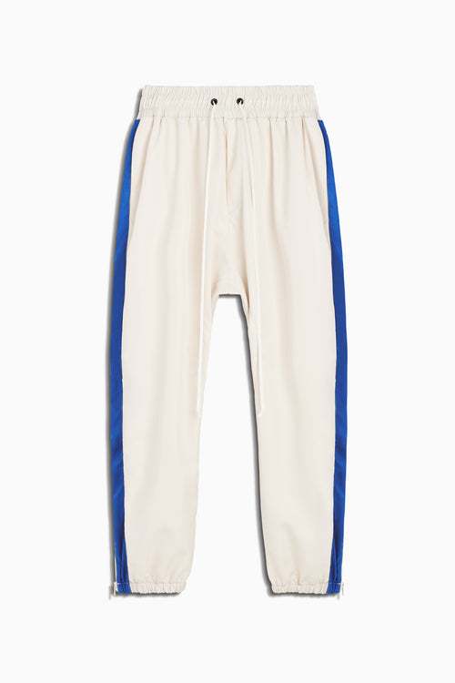 parachute track pant in ivory/cobalt by daniel patrick