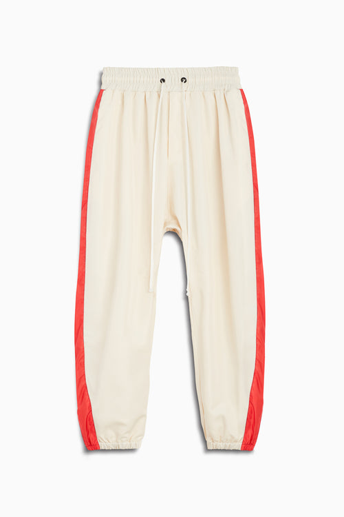 parachute track pant / ivory + red