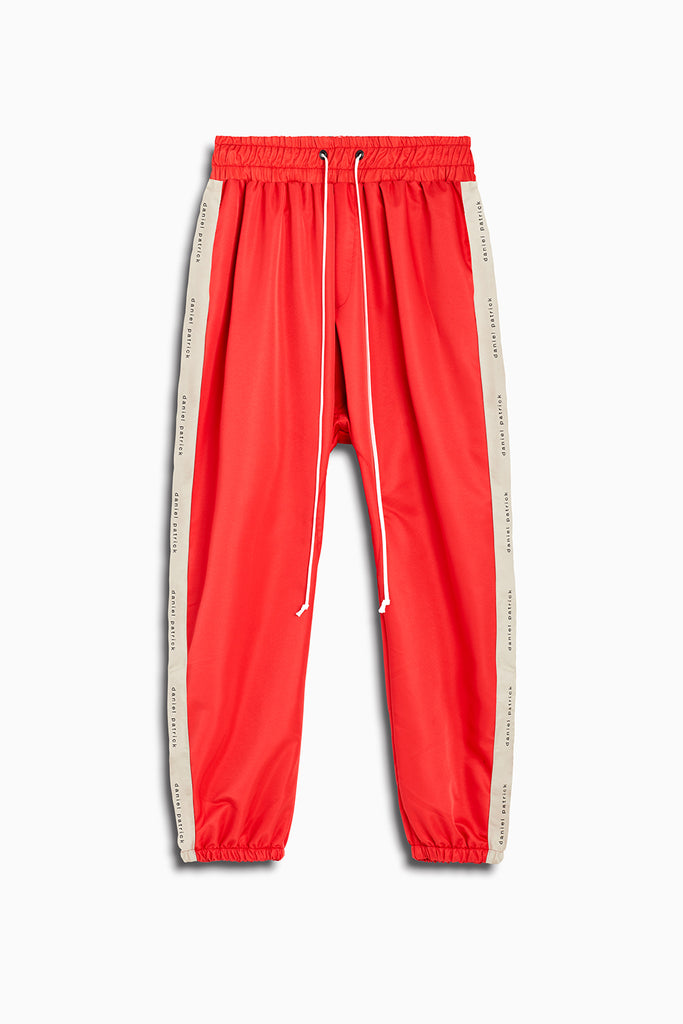 dp parachute track pant in red + natural by daniel patrick