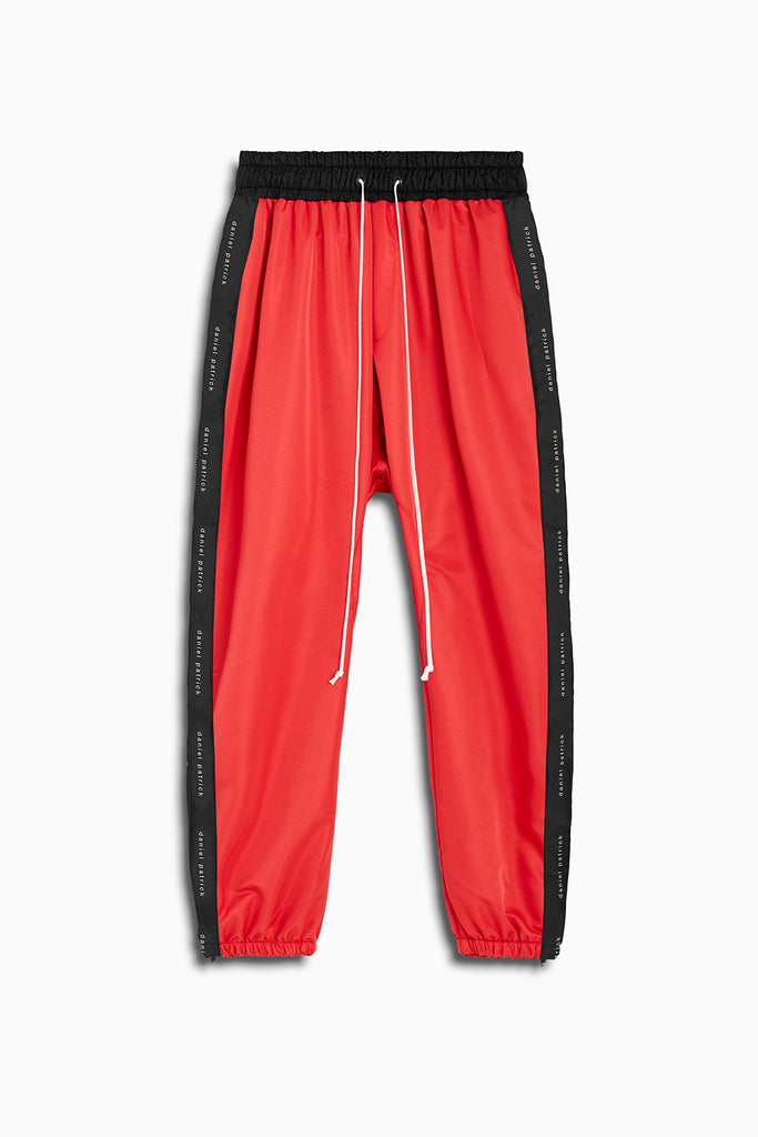 dp parachute track pant in red + black by daniel patrick
