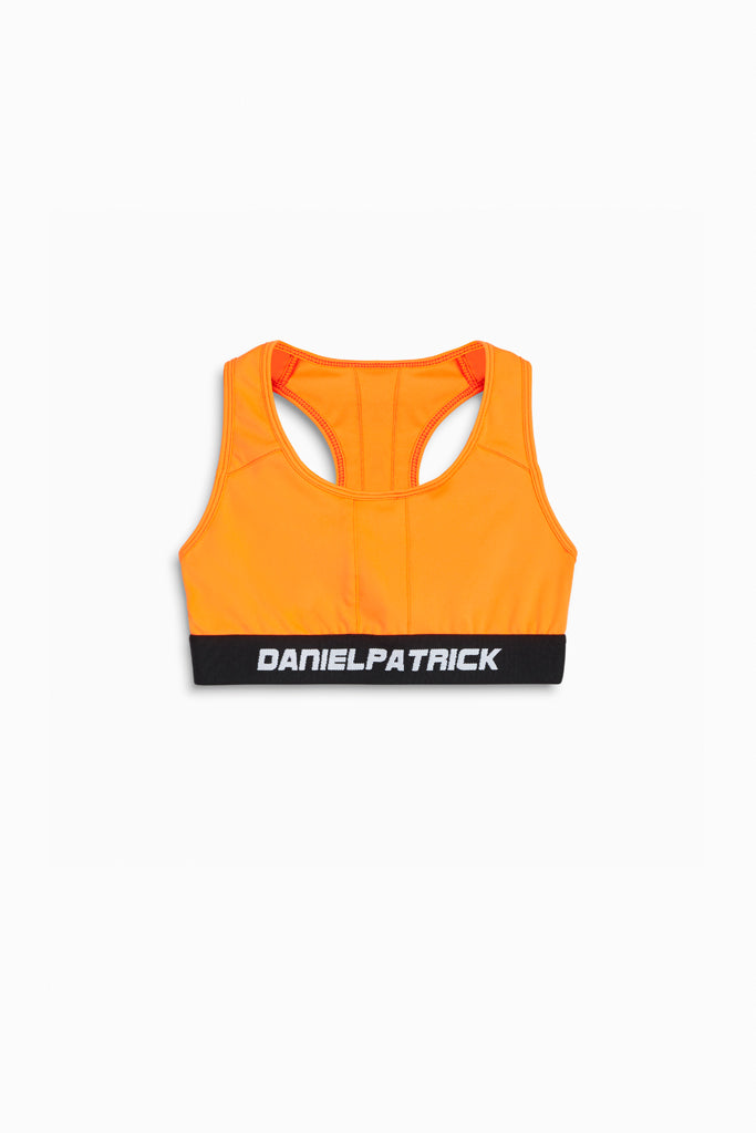 womens sports bra in neon orange by daniel patrick