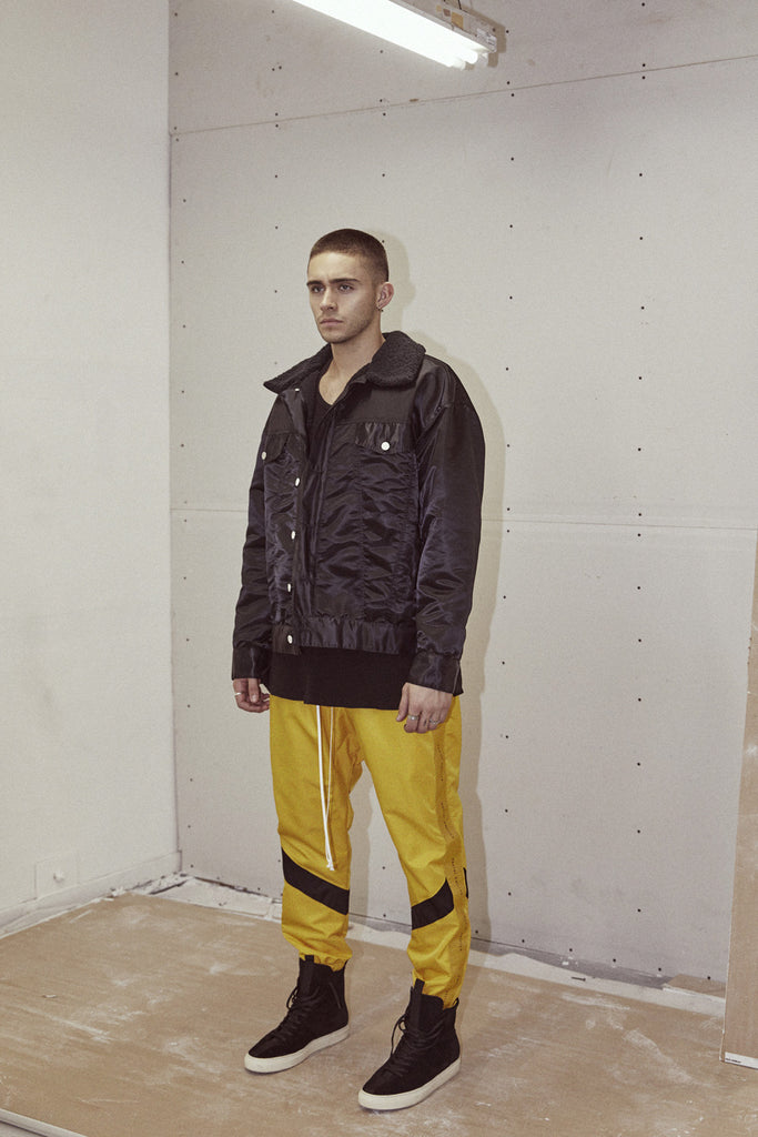 dp parachute track pant ii in yellow/black by daniel patrick