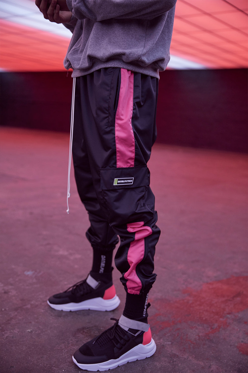 cargo parachute track pant in black/wildflower pink by daniel patrick