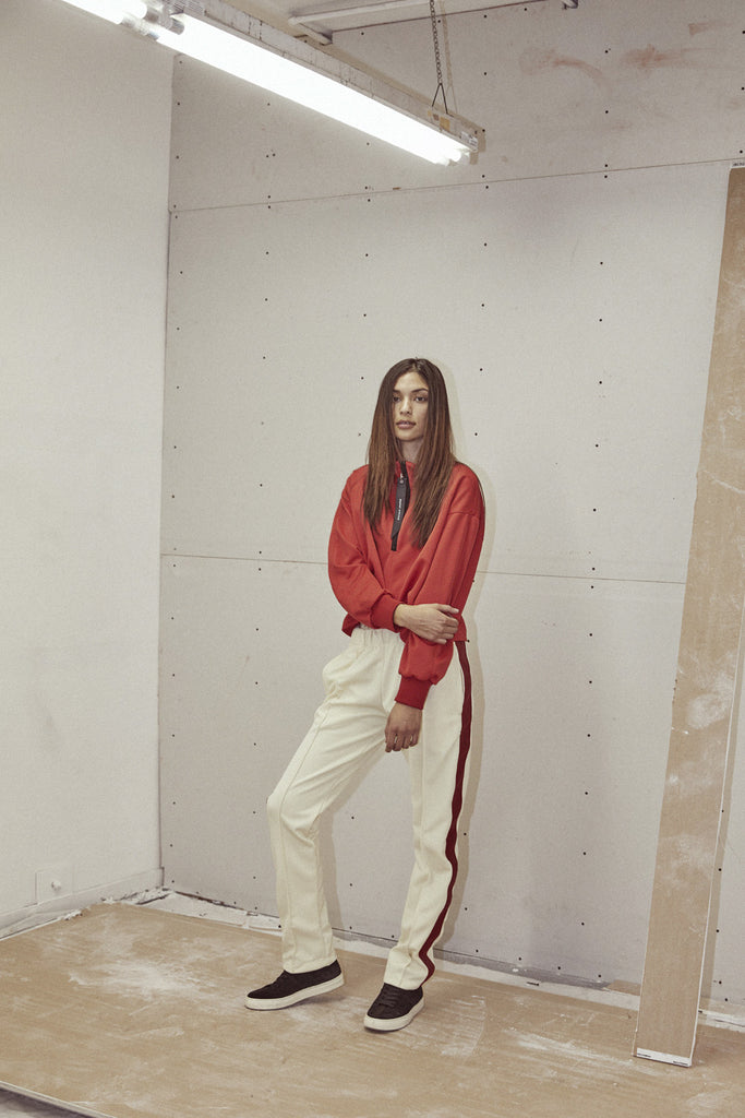 heroine track pant in ivory/red by daniel patrick