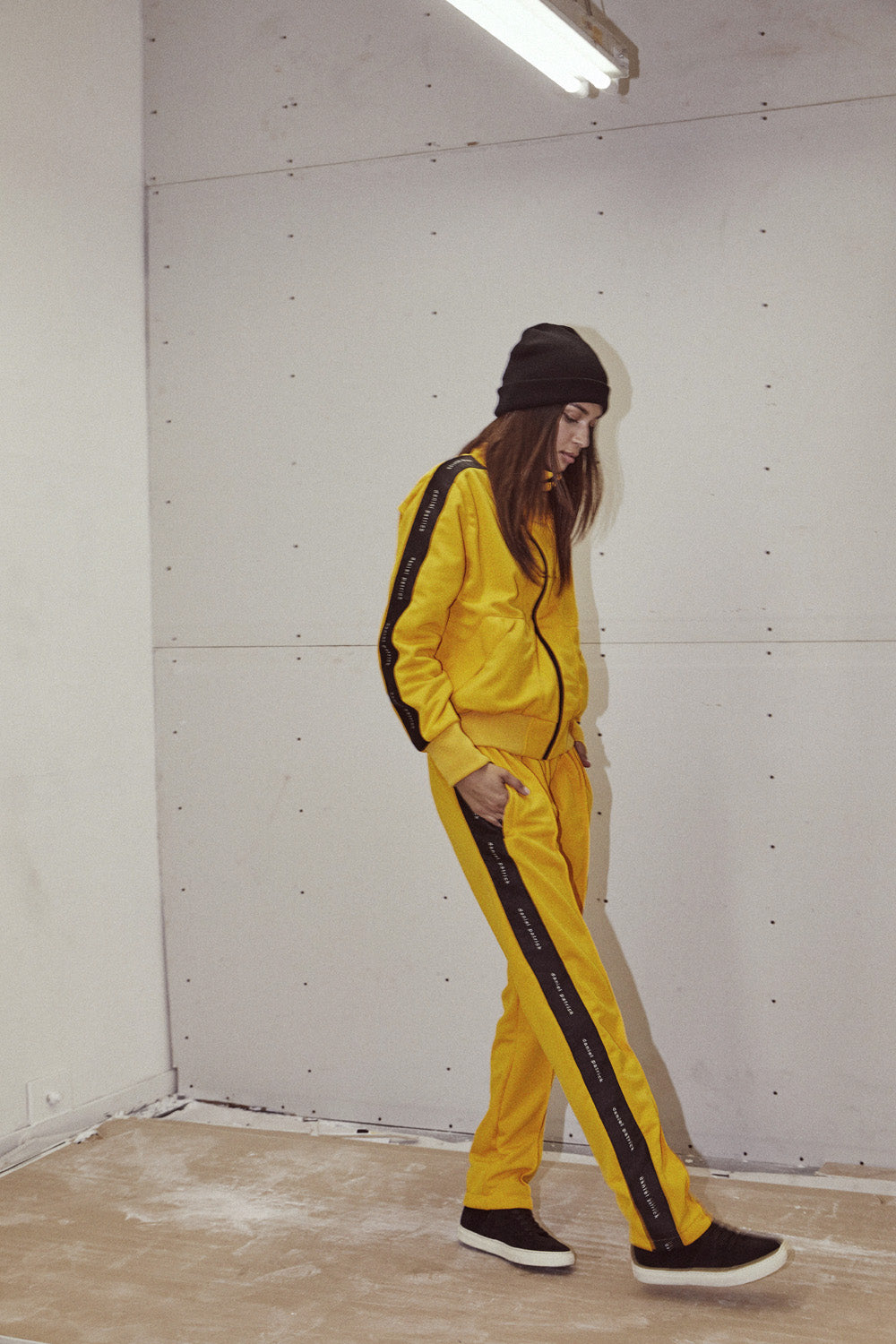 heroine track pant in yellow/black by daniel patrick
