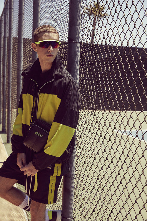 panel track jacket / black + citrus lime