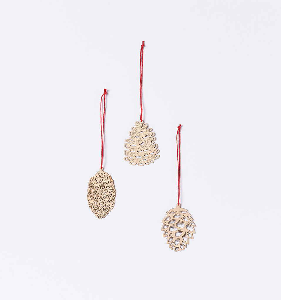 henderson dry goods woodcut pinecone ornaments