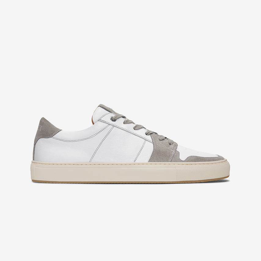 Profile view of the Men's Court Sneaker in Blanco White upper /  cream sole