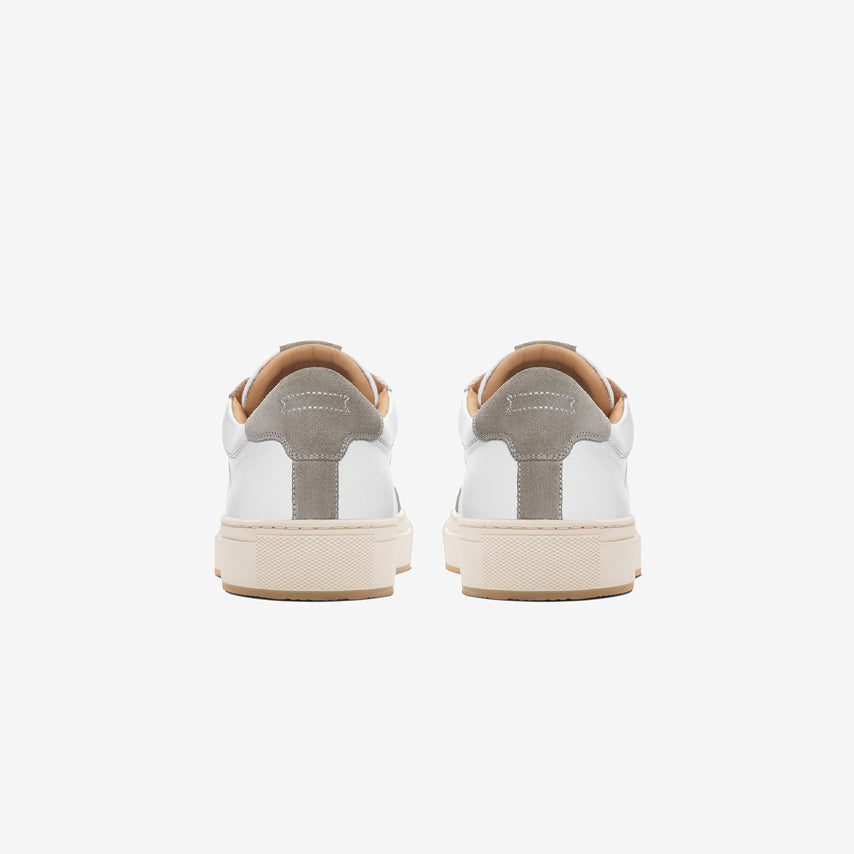Rear view of the Men's Court Sneaker in Blanco White upper /  cream sole